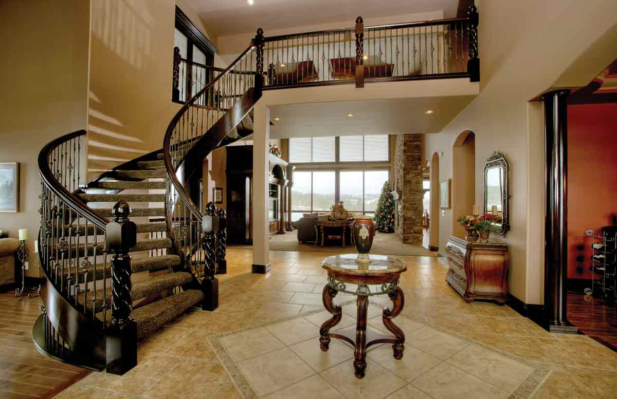 Maple Curved Stair With Carpeted Treads And Open Riser Stairs Spindles Railings