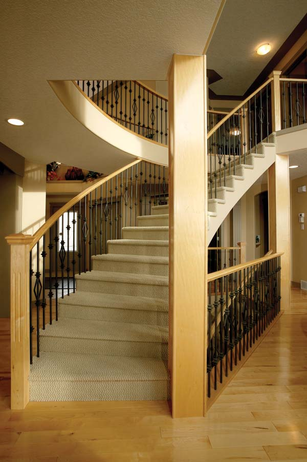 Maple Curved Stair with Carpeted Treads SSR