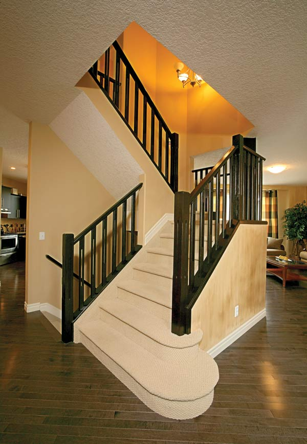 Straight Stair with Carpet Treads and Wood Spindles SSR
